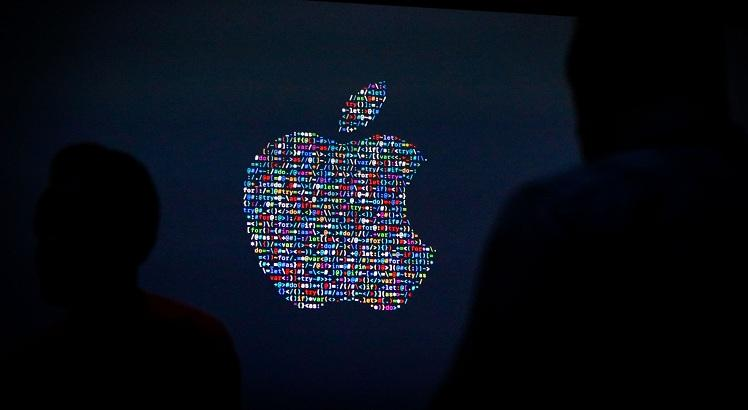(FILES) This file photo taken on June 13, 2016 shows the Apple logo displayed on a screen at Apple's annual Worldwide Developers Conference presentation at the Bill Graham Civic Auditorium in San Francisco, California. Apple has issued a security update to fix vulnerabilities found after fierce spyware created by an Israeli firm was used to target an Emirati dissident, US media reported. The company released its latest iOS version, 9.3.5, on August 25, 2016, which the New York Times said was meant to fix three security vulnerabilities in Apple products.  / AFP / GABRIELLE LURIE